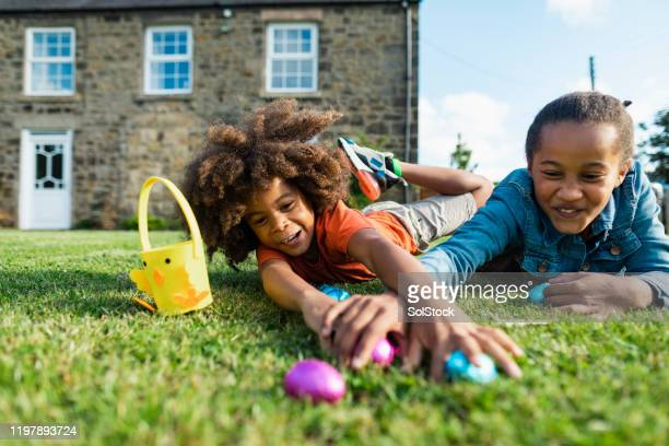 easter with my sister! - easter egg hunt stock pictures, royalty-free photos & images