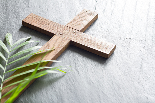 Easter wooden cross on black marble background religion abstract palm sunday concept 1092059836