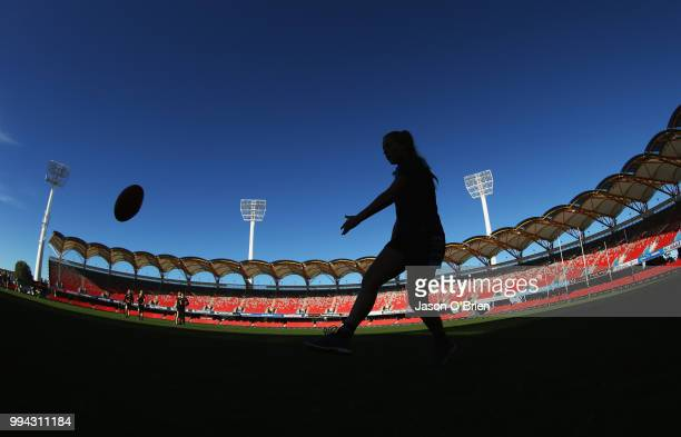 Eastern Allies players warm up during the AFLW U18 Championships match between Eastern Allies and Central Allies at Metricon Stadium on July 9 2018...