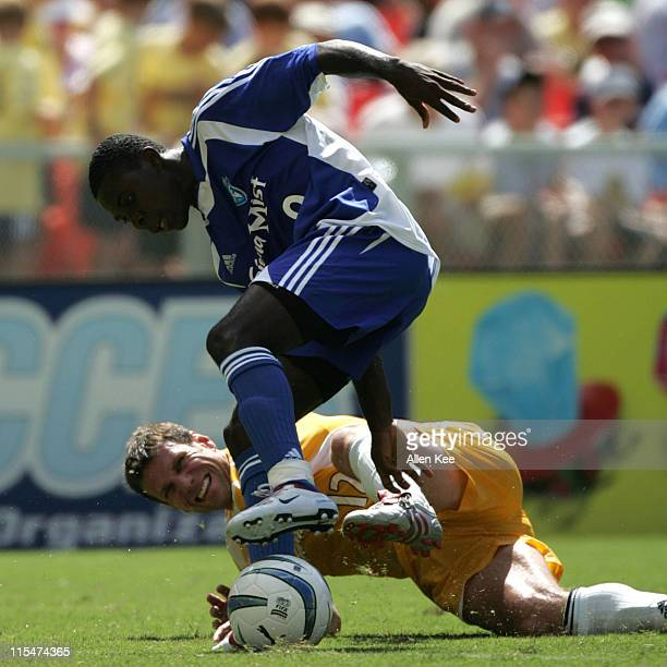 Eastern conference All Star Freddy Adu battles Jeff Agoos from the western conference for the ball during the 2004 MLS All Star Game. The Eastern...