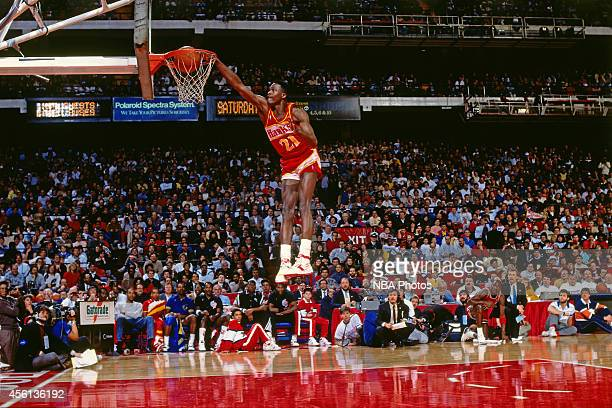 Eastern Conference All-Star Dominique Wilkins of the Atlanta Hawks dunks during the Slam Dunk Contest during the 1988 NBA All-Star Game on February...