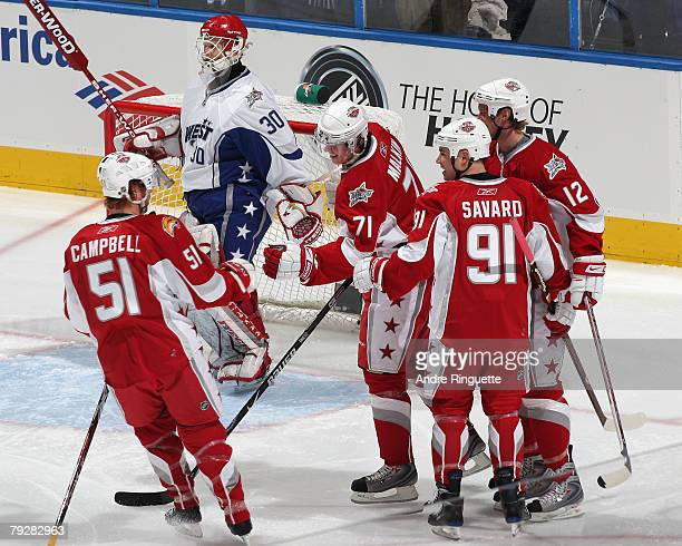 Eastern Conference AllStar Eric Staal of the Carolina Hurricanes scores a goal against Western Conference AllStar Chris Osgood of the Detroit Red...