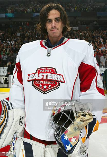 Eastern Conference AllStar goaltender Ryan Miller of the Buffalo Sabres skates on the ice with a goaltender mask painted in honor of US troops over...