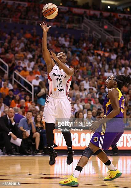 Eastern Conference AllStar Ivory Latta of the Washington Mystics lays up a shot past Western Conference AllStar Nneka Ogwumike of the Los Angeles...