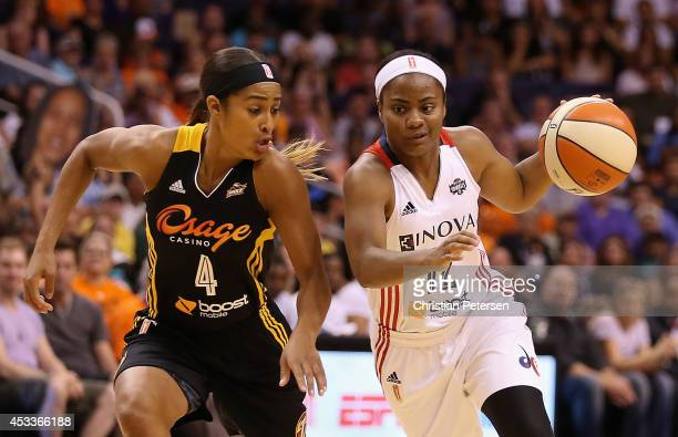 Eastern Conference AllStar Ivory Latta of the Washington Mystics drives the ball past Western Conference AllStar Glory Johnson of the Tulsa Shock...