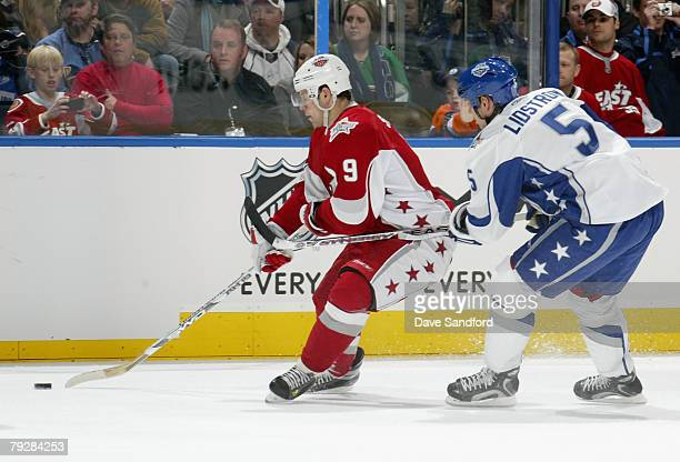 Eastern Conference AllStar Jason Spezza of the Ottawa Senators moves the puck against Nicklas Lidstrom of the Detroit Red Wings during the 56th NHL...