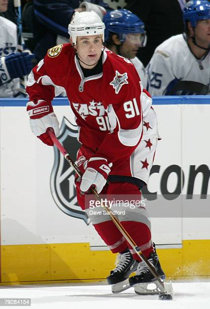 Eastern Conference AllStar Marc Savard of the Boston Bruins moves the puck during the 56th NHL AllStar Game at Philips Arena on January 27 2008 in...