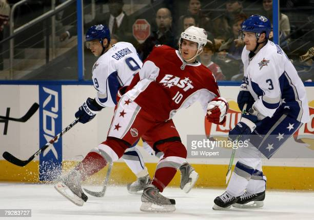Eastern Conference AllStar Mike Richards of the Philadelphia Flyers stops in front of Dion Phaneuf of the Calgary Flames during the 56th NHL AllStar...