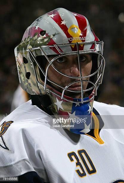 Eastern Conference AllStar Ryan Miller of the Buffalo Sabres warms up in a goalie mask painted in honor of the US troops serving overseas during the...