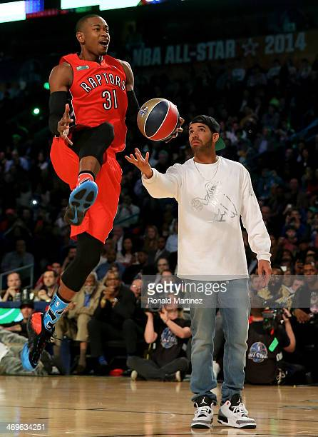 Eastern Conference AllStar Terrence Ross of the Toronto Raptors takes the ball from Drake during the Sprite Slam Dunk Contest 2014 as part of the...