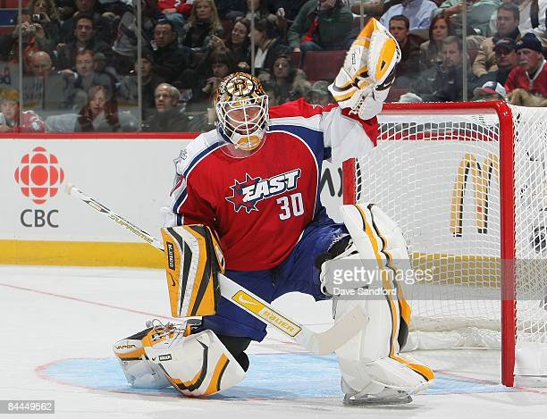 Eastern Conference AllStar Tim Thomas of the Boston Bruins makes a glove save on the puck during the 2009 NHL AllStar game at the Bell Centre on...