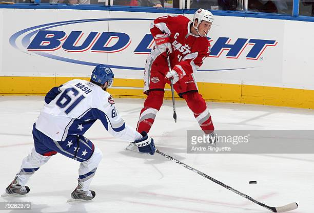 Eastern Conference AllStar Vincent Lecavalier of the Tampa Bay Lightning passes the puck by Western Conference AllStar Rick Nash of the Columbus Blue...