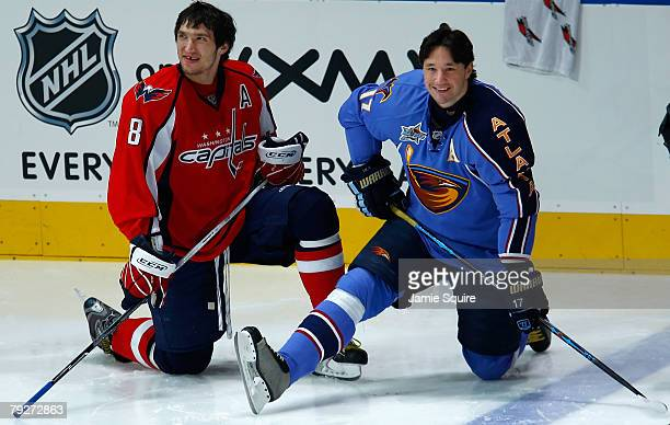 Eastern Conference AllStars Alex Ovechkin of the Washington Capitals and Ilya Kovalchuk of the Atlanta Thrashers look on during the Dodge/NHL...
