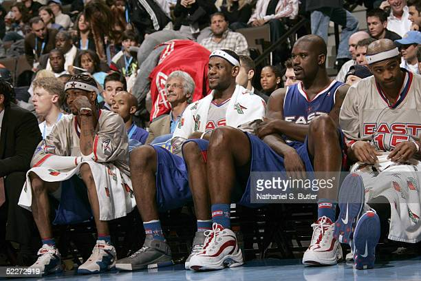 Eastern Conference AllStars Allen Iverson LeBron James Shaquille O'Neal and Vince Carter watch during game action against the Western Conference...