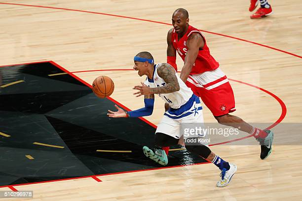 Eastern Conference Boston Celtics Isaiah Thomas and Western Conference Los Angeles Lakers Kobe Bryant race for the ball during the NBA allstar game...