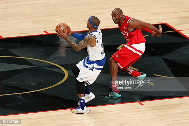 Eastern Conference Boston Celtics Isaiah Thomas gets chased by Western Conference Los Angeles Lakers Kobe Bryant race for the ball during the NBA...