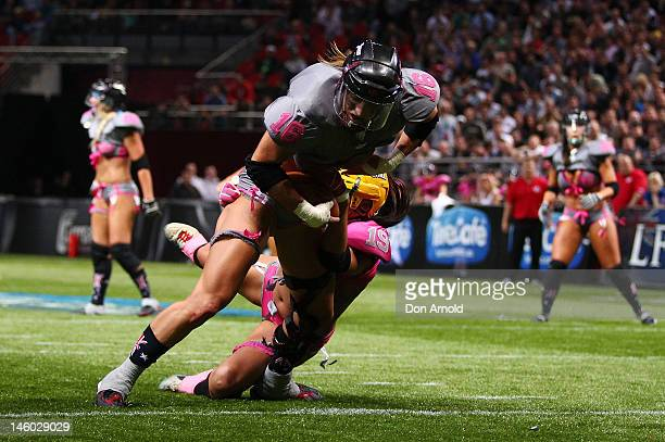 Eastern Conference player Saige Steinmetz pushes over for a touchdown during games two of the AllStar Lingerie Football League tour at Allphones...