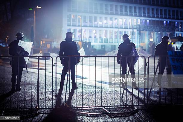 eastern europe riot police behind the fence - riot police stock pictures, royalty-free photos & images