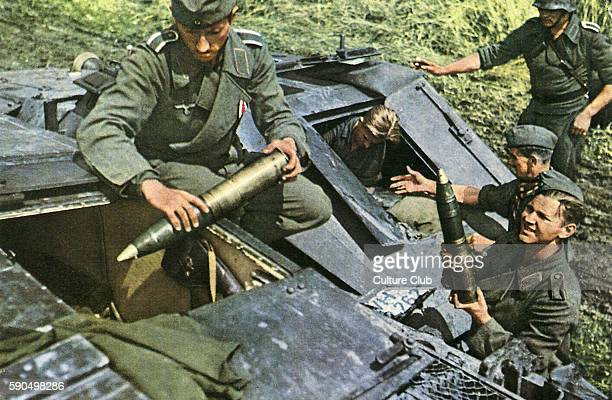 WW2 Eastern Front Soldiers load an assault cannon with ammunition