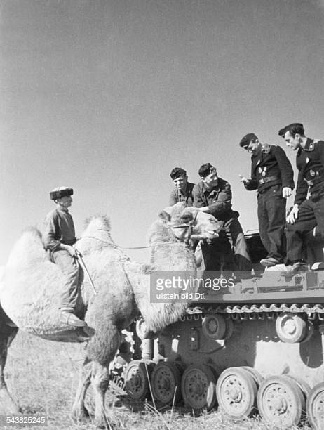 2WW eastern front soviet union war theater AG A / 1 armoured army Advance toward the Caucasus tank soldiers meet a tatar on his camel in the steppe...