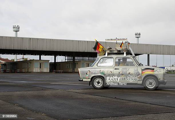 A eastern German car Trabant pasts the border checkpoint HelmstedtMarienborn memorial on October 7 2009 in Marienborn Germany The Border checkpoint...