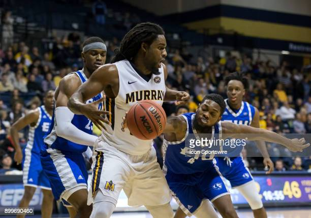 Eastern Illinois guard Montell Goodwin knocks a pass away from Murray State forward Terrell Miller Jr during the college basketball game between the...