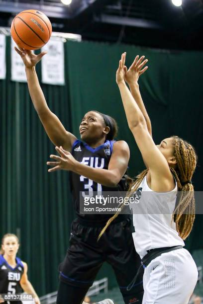 Eastern Illinois Panthers forward Jalisha Smith shoots as Cleveland State Vikings guard Mariah White defends during the second quarter of the women's...