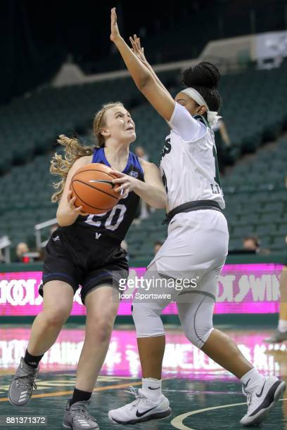 Eastern Illinois Panthers guard Danielle Berry drives to the basket against Cleveland State Vikings guard Khayla Livingston during the first quarter...