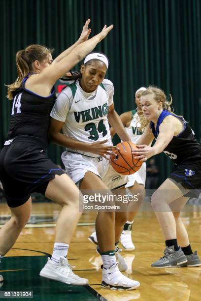 Eastern Illinois Panthers guard Danielle Berry knocks the ball away from Cleveland State Vikings forward Shadae Bosley as Eastern Illinois Panthers...
