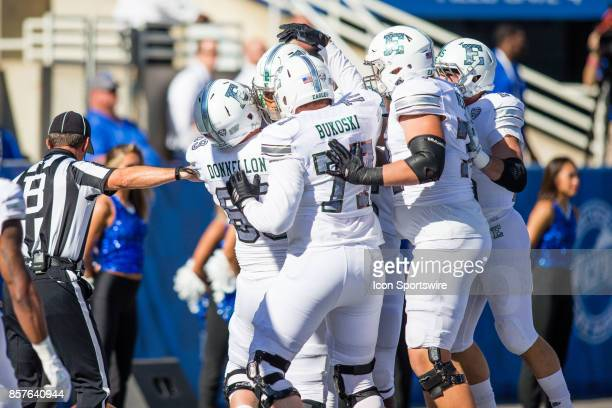 Eastern Michigan celebrates their first touchdown just moments into the game during a regular season college football game between the Eastern...