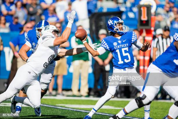 Eastern Michigan defensive lineman Jeremiah Harris strips the ball from Kentucky quarterback Stephen Johnson during a regular season college football...