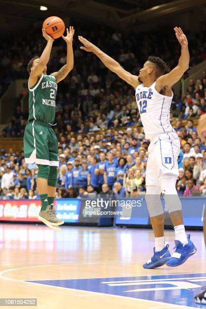 Eastern Michigan Eagles forward Andre Rafus Jr goes for the three while Duke Blue Devils forward Javin DeLaurier tries to block him during the 2nd...