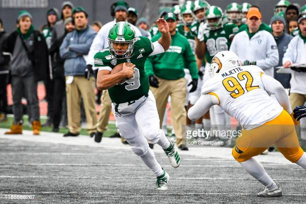 Eastern Michigan Eagles quarterback Mike Glass III runs past Kent State Golden Flashes defensive lineman Theo Majette during the Eastern Michigan...