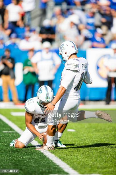 Eastern Michigan kicker Paulie Fricano kicks the extra point while wide receiver Isaac Holder holds the ball during a regular season college football...