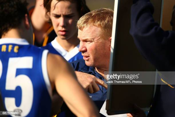 Eastern Ranges coach Darren Bewick talks to his players at quarter time during the round seven TAC Cup match between the Eastern Ranges and the...