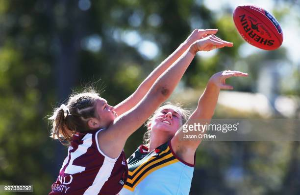 Eastern's Alexia Hamilton challenges for the ball with Queensland's Ruby Edmeades during the AFLW U18 Championships match between Queensland and...