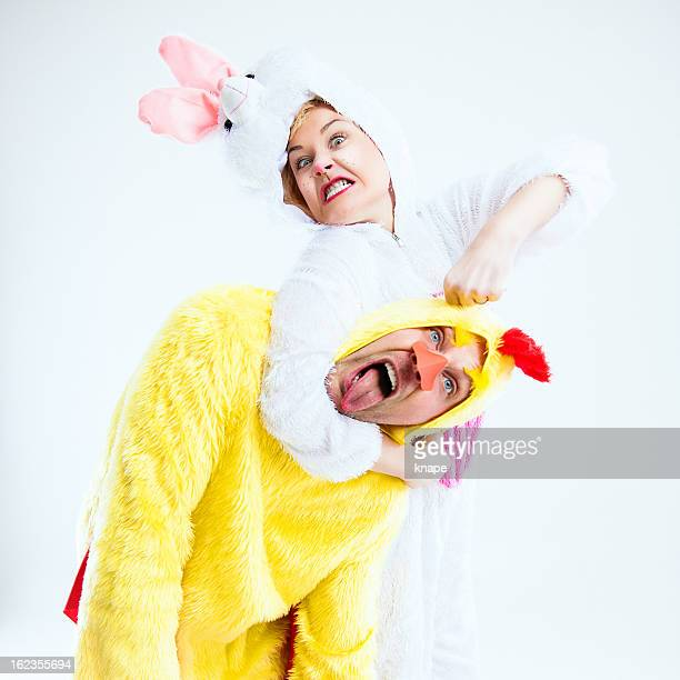 easterrabbit and chicken fighting - easter bunny costume stock pictures, royalty-free photos & images