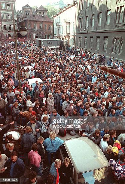 EastGerman refugees penned behind barriers outside the West German embassy wait for the buses to take them to the railway station to leave Prague 04...