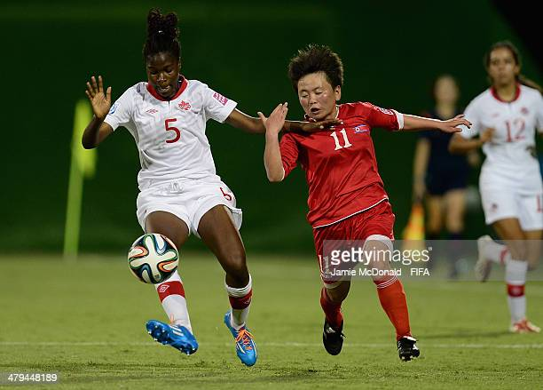 Easther Mayi Kith of Canada battles with Sung Hyang Sim of Korea DPR during the FIFA U17 Women's World Cup Group B match between Korea DPR and Canada...