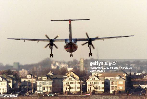 """""""Eastie's Woes""""-A plane lands on Runway 4Left as Eastie's Bayswater st looms in backgound."""