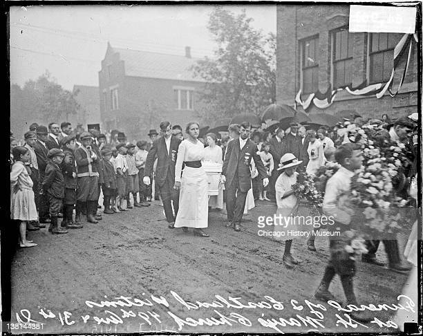 Eastland disaster, Francis and Florian Nowak's, funeral procession, children carrying flowers precede the pallbearers, Chicago, Illinois, July 29,...