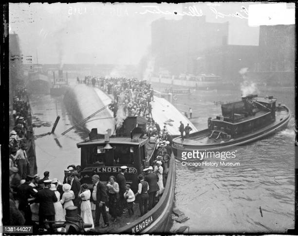 Eastland disaster, the Kenosha, a tugboat, rescuing survivors from the hull of the overturned steamer, Chicago, Illinois, July 24, 1915.