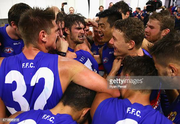 Easton Wood and Lin Jong of the Bulldogs celebrate after the round five AFL match between the Sydney Swans and the Western Bulldogs at SCG on May 2,...