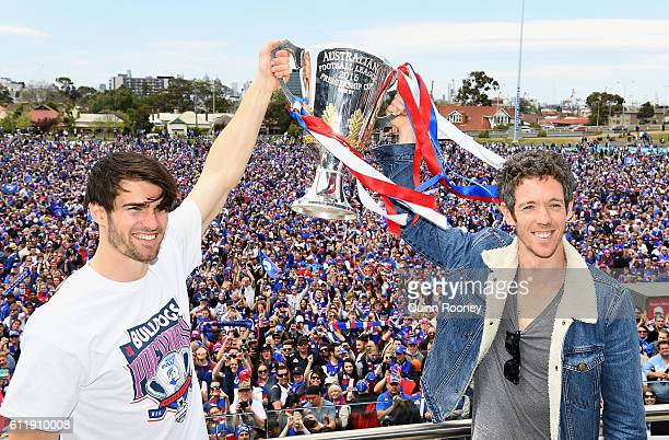 Easton Wood and Robert Murphy of the Bulldogs pose with the trophy during the Western Bulldogs AFL Grand Final celebrations at Whitten Oval on...