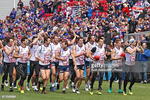 Easton Wood and the Bulldogs thanks their supporters in the crowd during the Western Bulldogs AFL media opportunity and training session at Whitten...