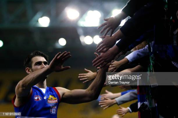 Easton Wood of the Bulldogs acknowledges the fans after the round 17 AFL match between the Western Bulldogs and Melbourne Demons at Marvel Stadium on...