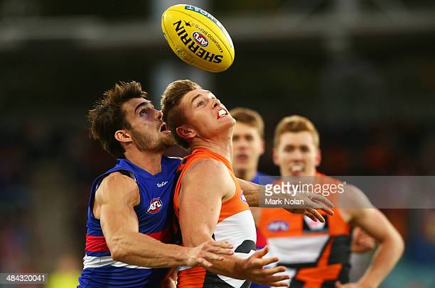 Easton Wood of the Bulldogs and Adam Tomlinson of the Giants contest possession during the round four AFL match between the Greater Western Sydney...
