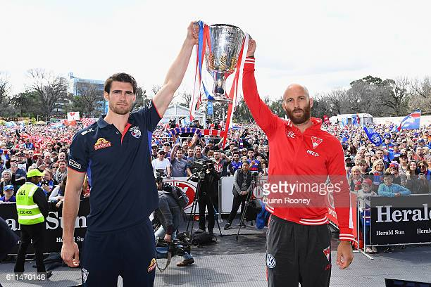 Easton Wood of the Bulldogs and Jarrad McVeigh of the Swans pose with the Premiership Cup on stage during the 2016 AFL Grand Final Parade on...