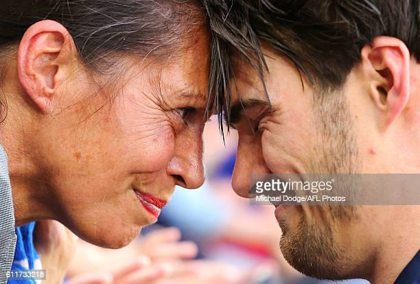 Easton Wood of the Bulldogs celebrates the win with his mum during the 2016 AFL Grand Final match between the Sydney Swans and the Western Bulldogs...