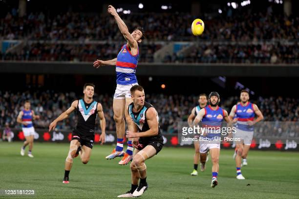 Easton Wood of the Bulldogs competes with Robbie Gray of the Power during the 2021 AFL Second Preliminary Final match between the Port Adelaide Power...